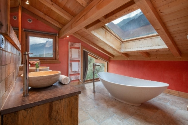 Bathroom with bath, double sink and toilet