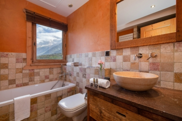 Shared bathroom with bathtub